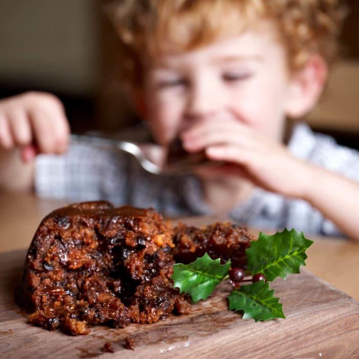 Boy enjoying a Figgy's Luxury Christmas Pudding