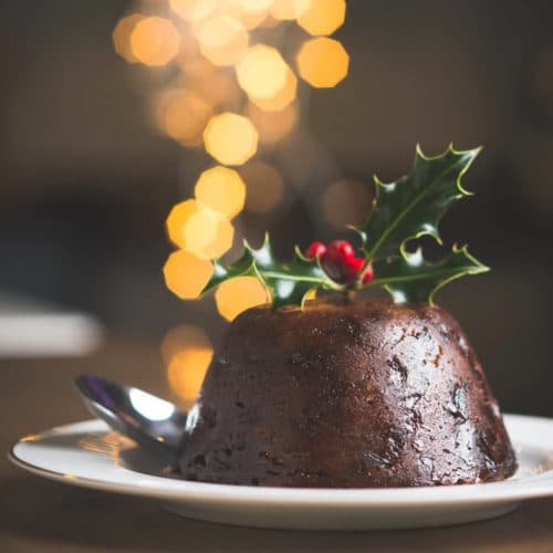 Figgy's luxury Xmas Pudding on a plate with holly